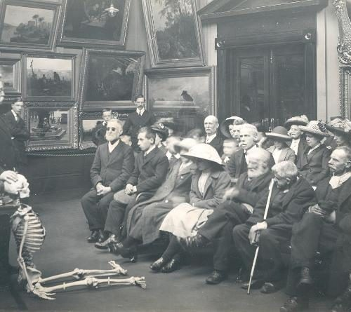 Blind adults listening to a short lecture at Sunderland Museum before examining a human skeleton, 1913. Tyne & Wear Archives & Museums.