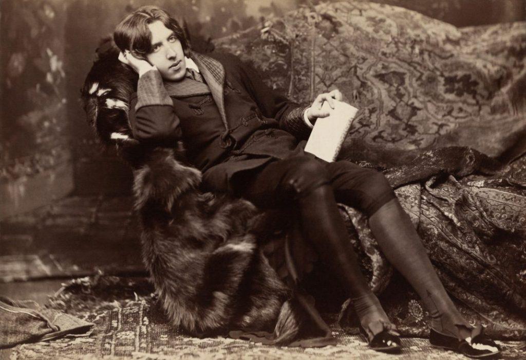 Oscar Wilde reclining with Poems, New York, 1882. By Napoleon Sarony.