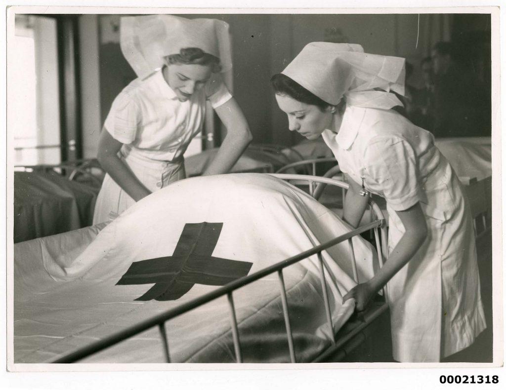 Two nurses on board hospital ship TSS ORANJE II, June 1941. Samuel J. Hood Studio Collection.