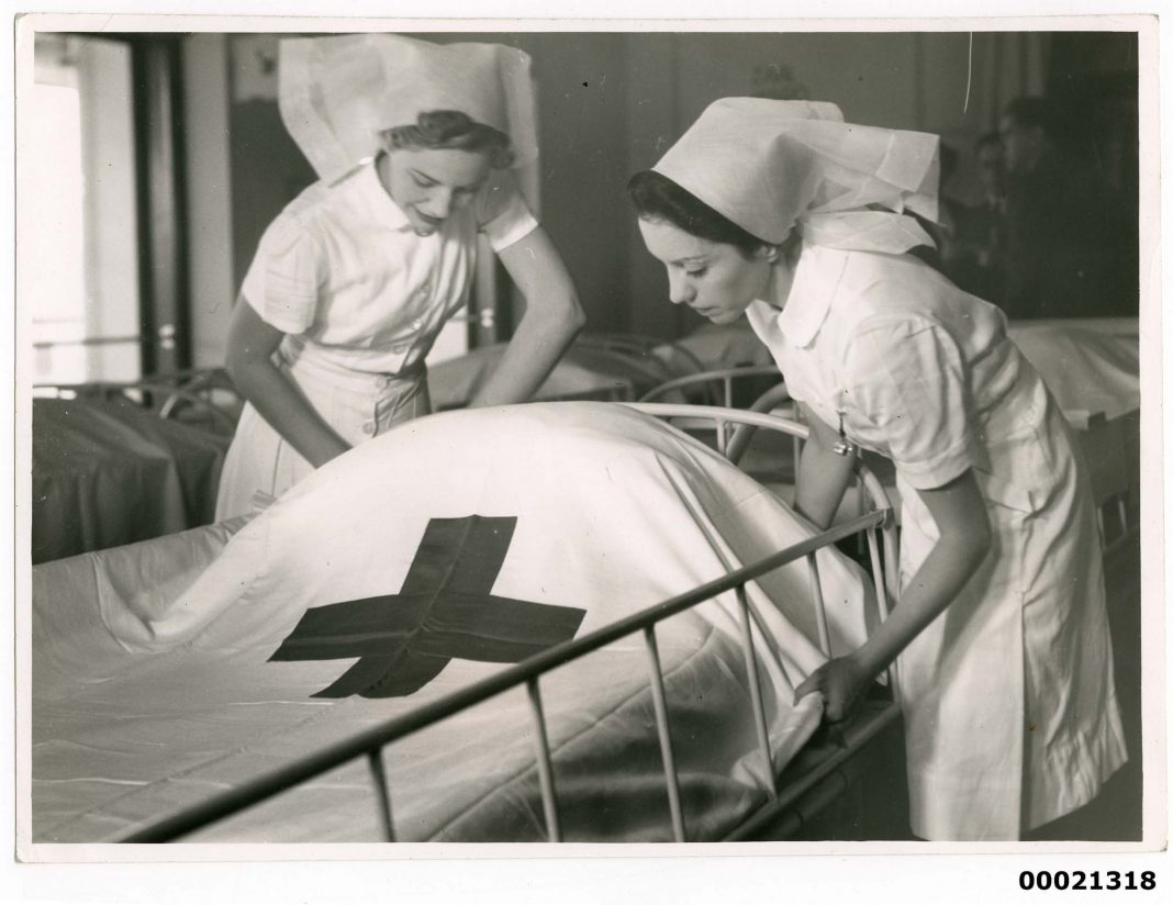 Two nurses on board hospital ship TSS ORANJE II, June 1941. Samuel J. Hood Studio Collection.