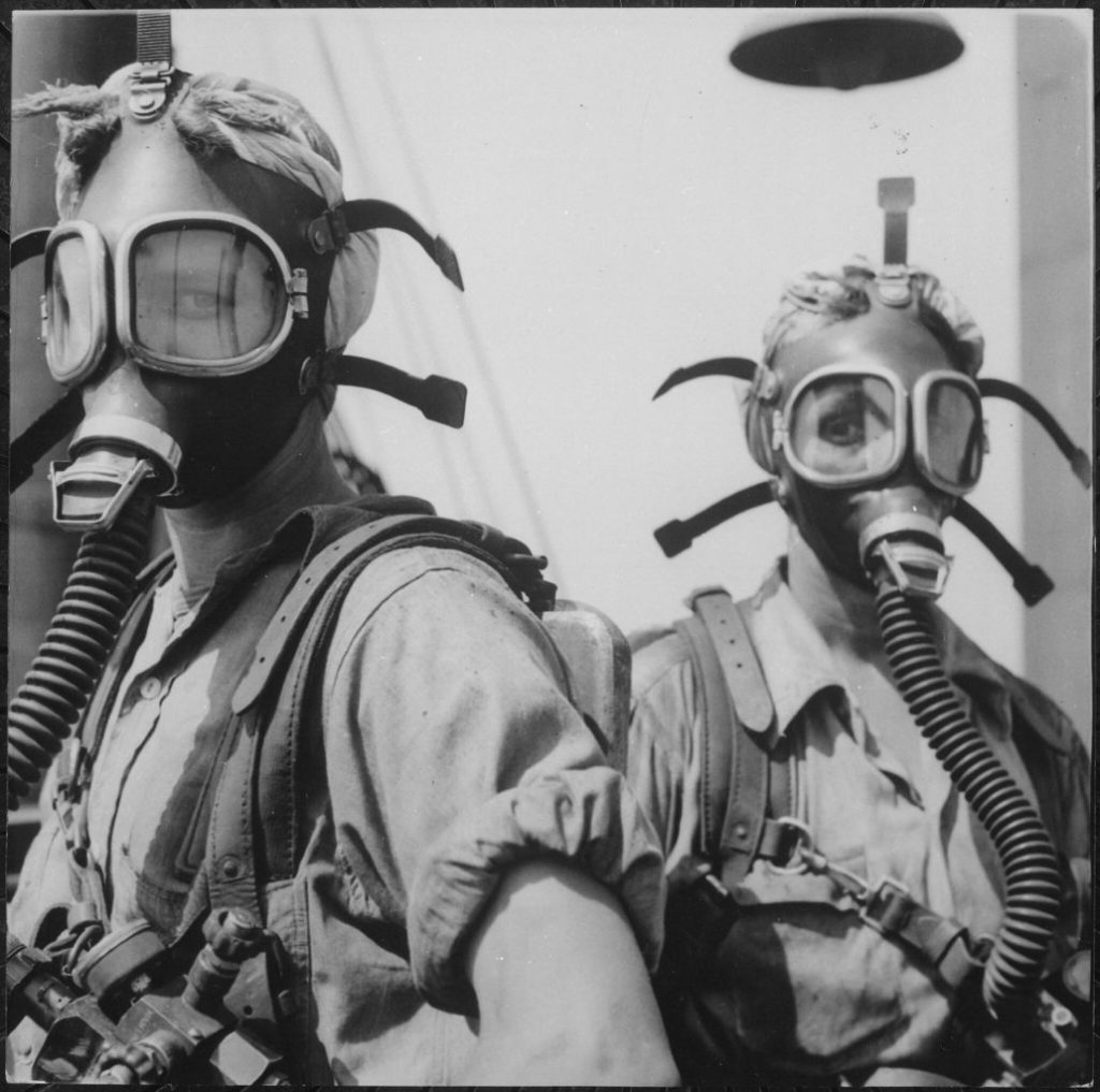 "Like Girls from Mars Are These ""Top Women"" at U.S. Steel's Gary, Indiana, Works. Their Job Is to Clean Up at Regular Intervals Around The Tops of Twelve Blast Furnaces. As A Safety Precaution, the Girls Wear Oxygen Masks., 1940 - 1945"